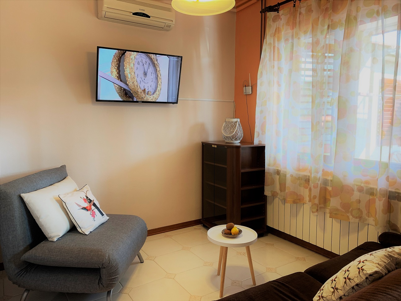 Rustico lounge living room with tv and aircon1290 pixela.jpg